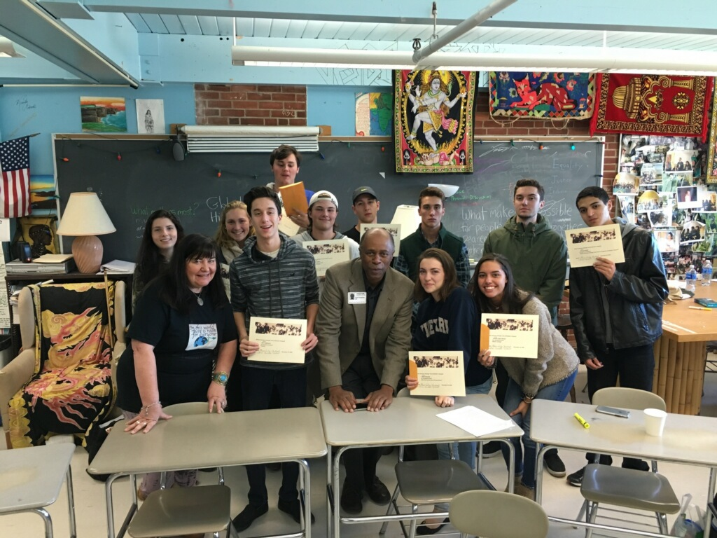 Winners of the 2017 Martha's Vineyard African-American Heritage Trail Projects among students in Elaine Weintraub's Global History Class pose with Ms. Weintraub and Ewell Hopkins, who graciously donated his time to help judge the projects and present the awards to the winners.